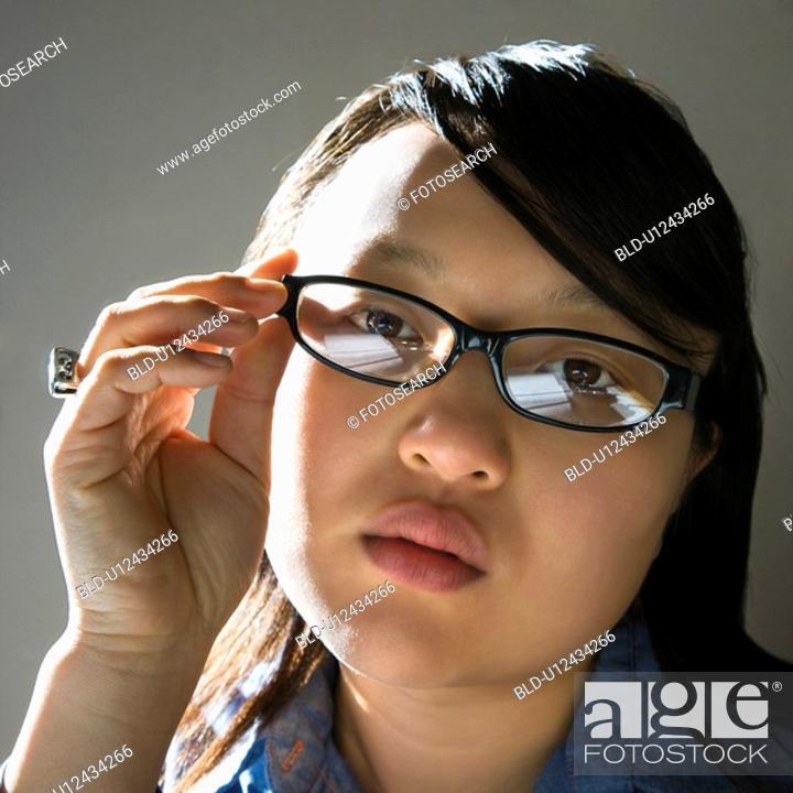 Stock Photo: Woman wearing eyeglasses.