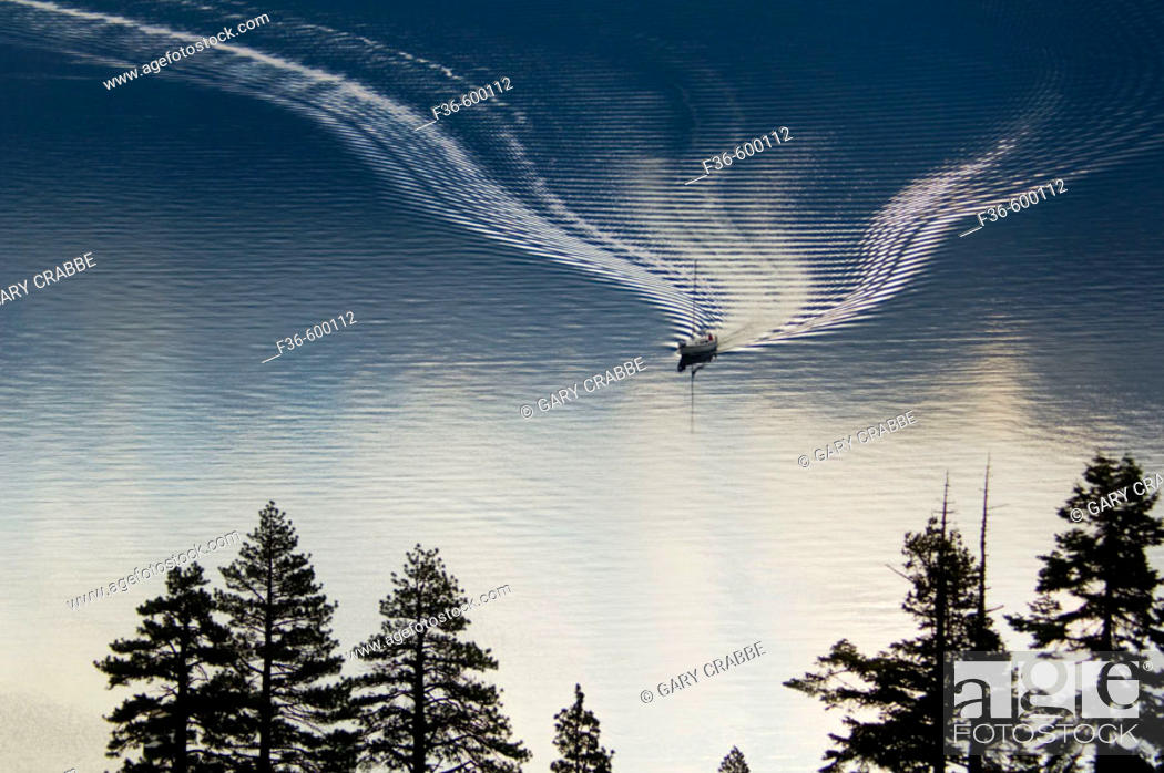 Stock Photo: Boat wake on still quiet water below trees, Emerald Bay State Park, South Lake Tahoe area, California.