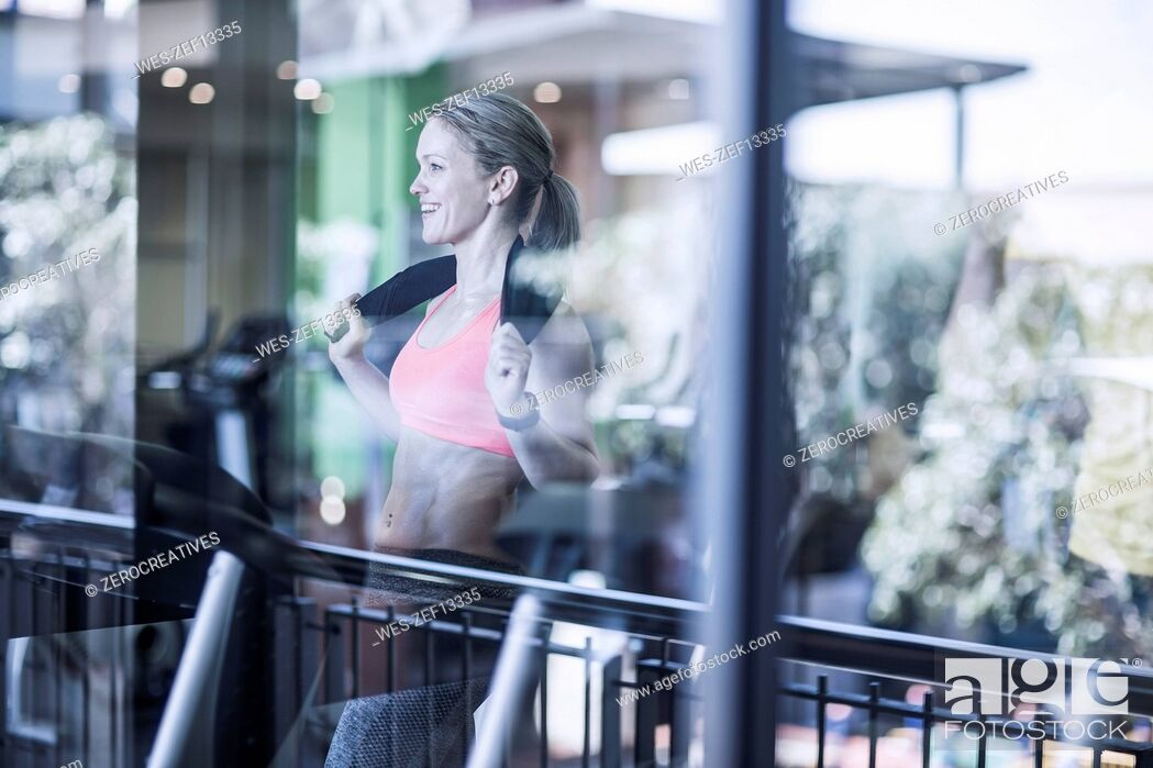 Stock Photo: Athletic woman on treadmill at the gym.