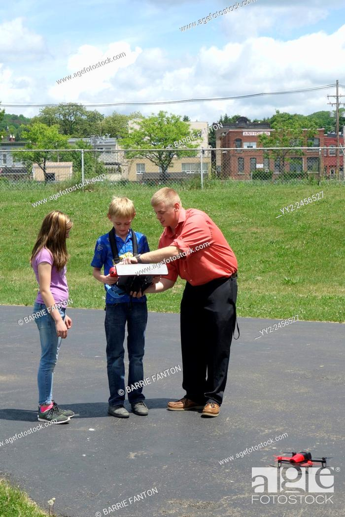 Stock Photo: Students Learning to Flying Drone, Wellsville, New York, United States.