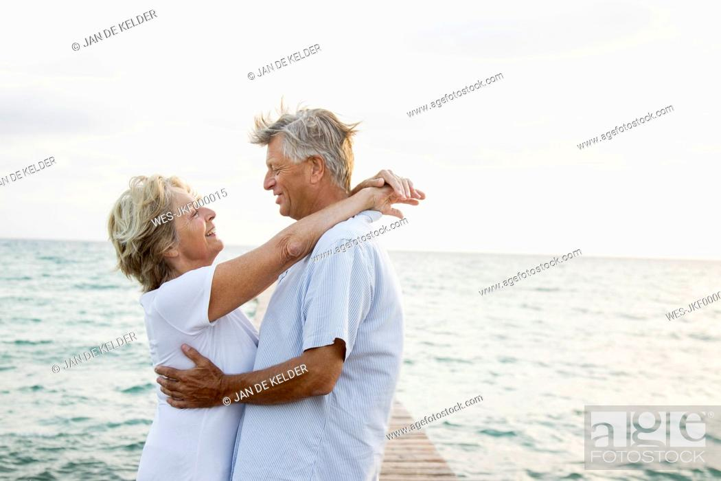 Stock Photo: Spain, Senior couple embracing at the sea.
