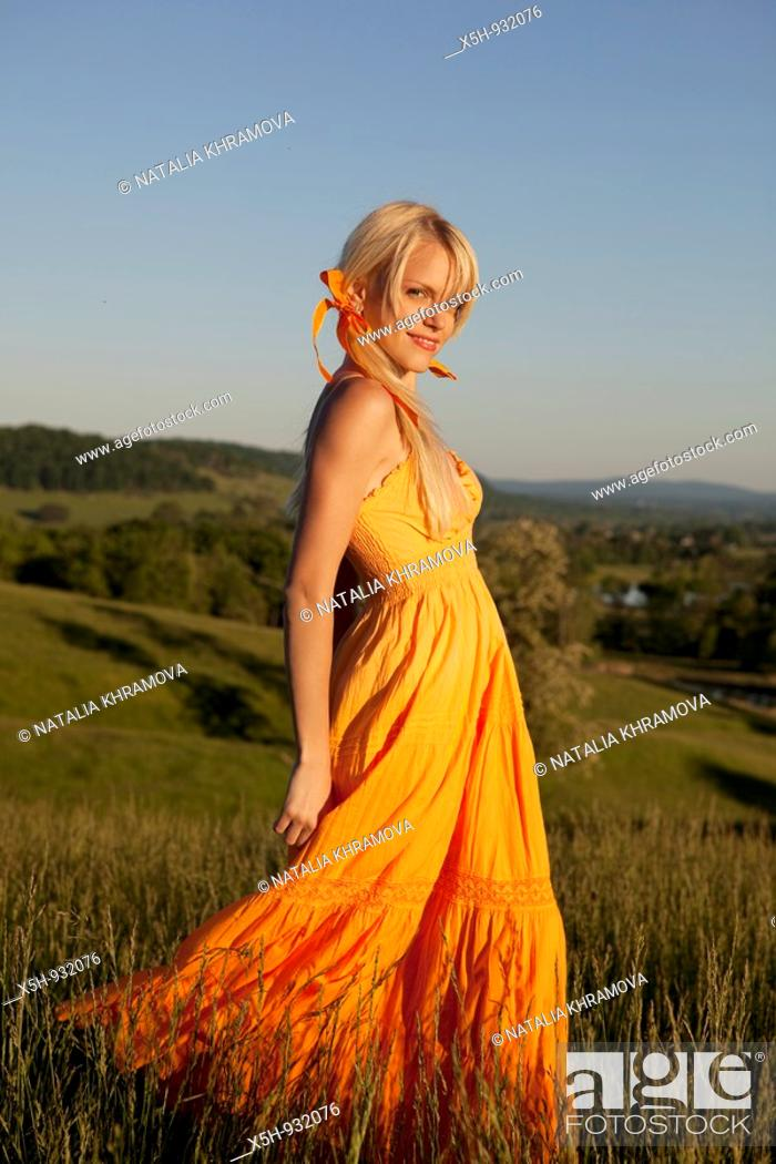 Stock Photo: one young woman walkinh in a filed.