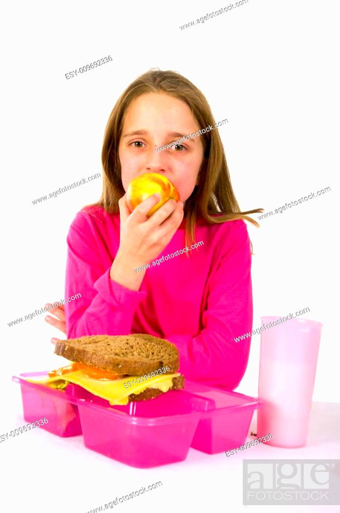 Stock Photo: eating an apple while hving lunch.