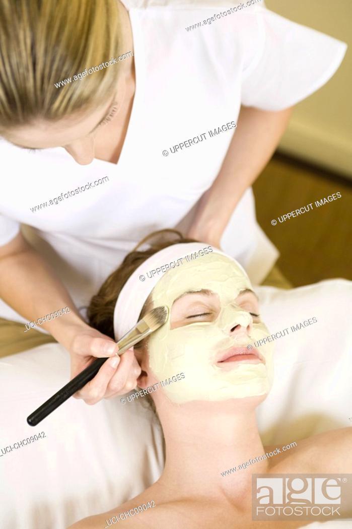 Stock Photo: Woman receiving facial spa treatment.