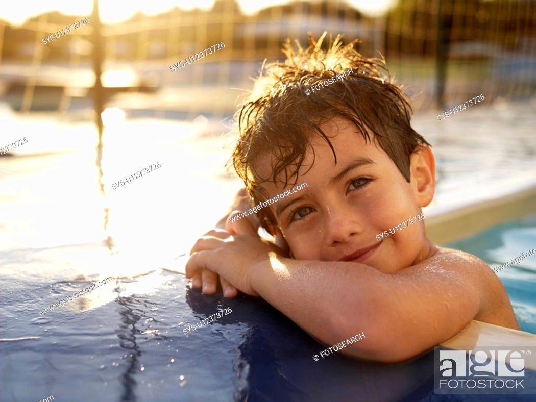 Stock Photo: Boy in swimming pool portrait.