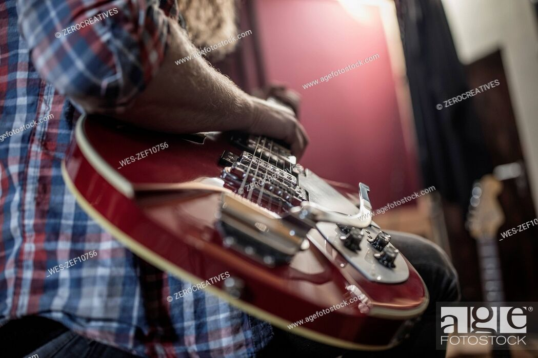 Stock Photo: Close-up of man playing electric guitar.