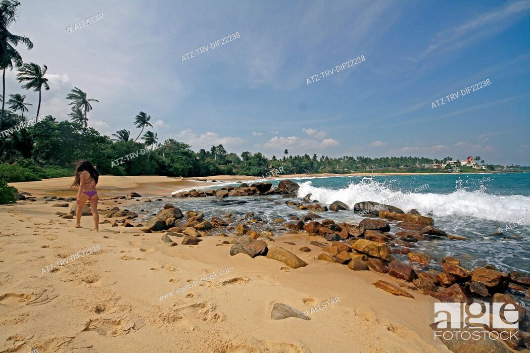 Stock Photo: GOLDEN BEACH, ROCKS & MODEL; TANGALLE, SRI LANKA; 16/03/2013.