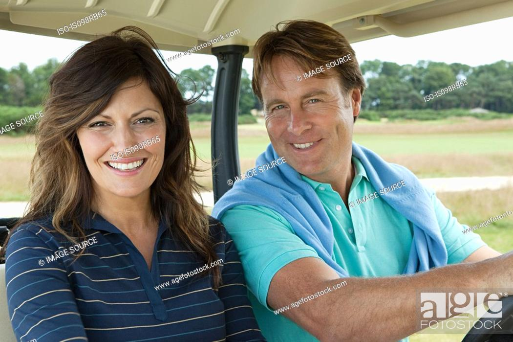 Stock Photo: Couple in golf cart.