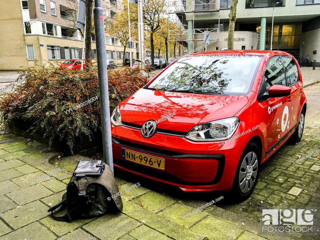 Stock Photo: Tilburg, Netherlands. Waiting for a Greenwheels Car to open up it's doors at the exact right time.
