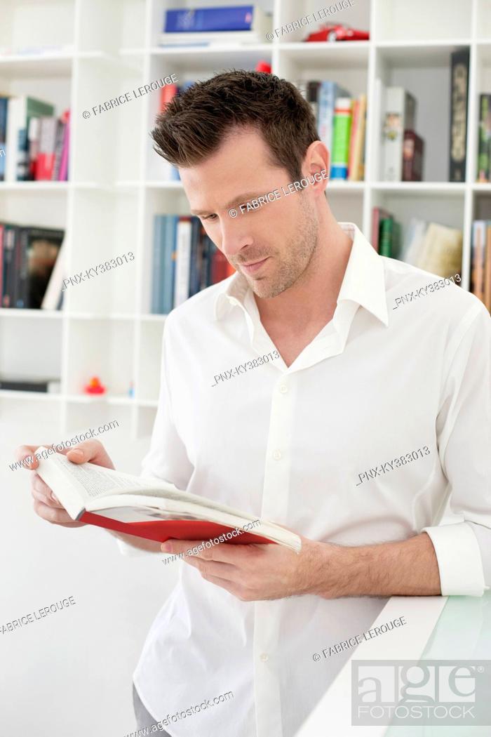 Stock Photo: Man reading a book.