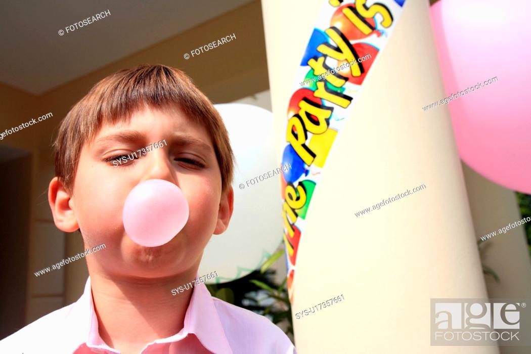 Stock Photo: Boy doing bubble with gum.