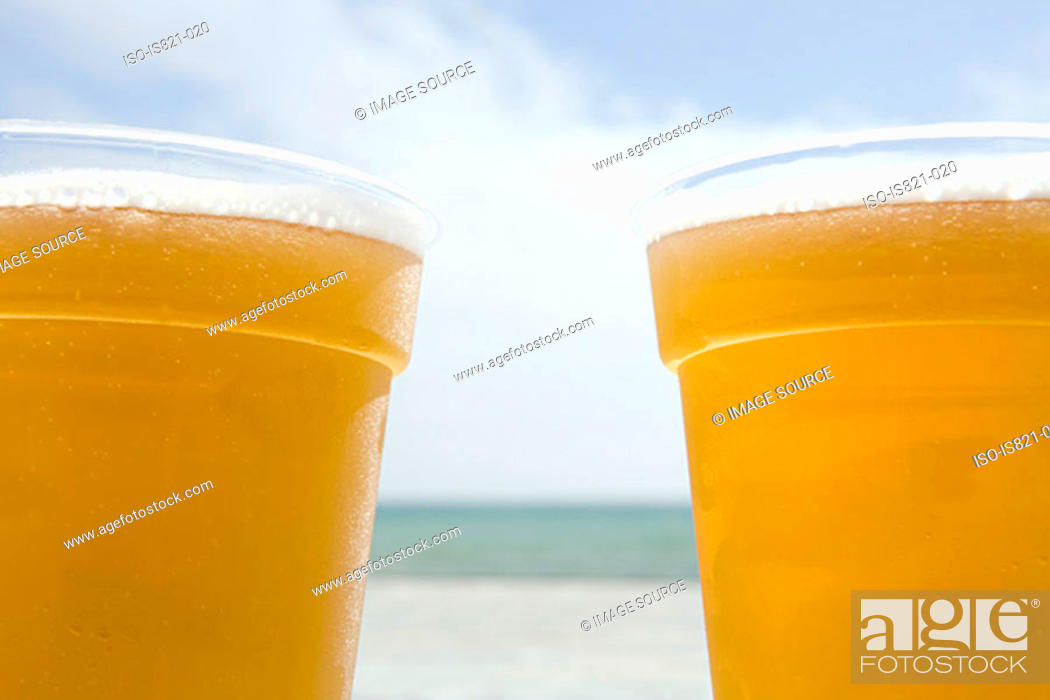 Stock Photo: Beers by the sea.