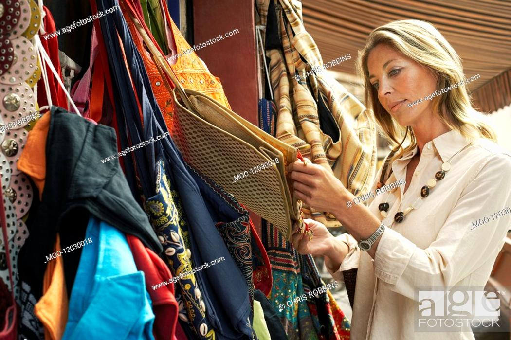 Stock Photo: Tourist Shopping for Bags on Stall.