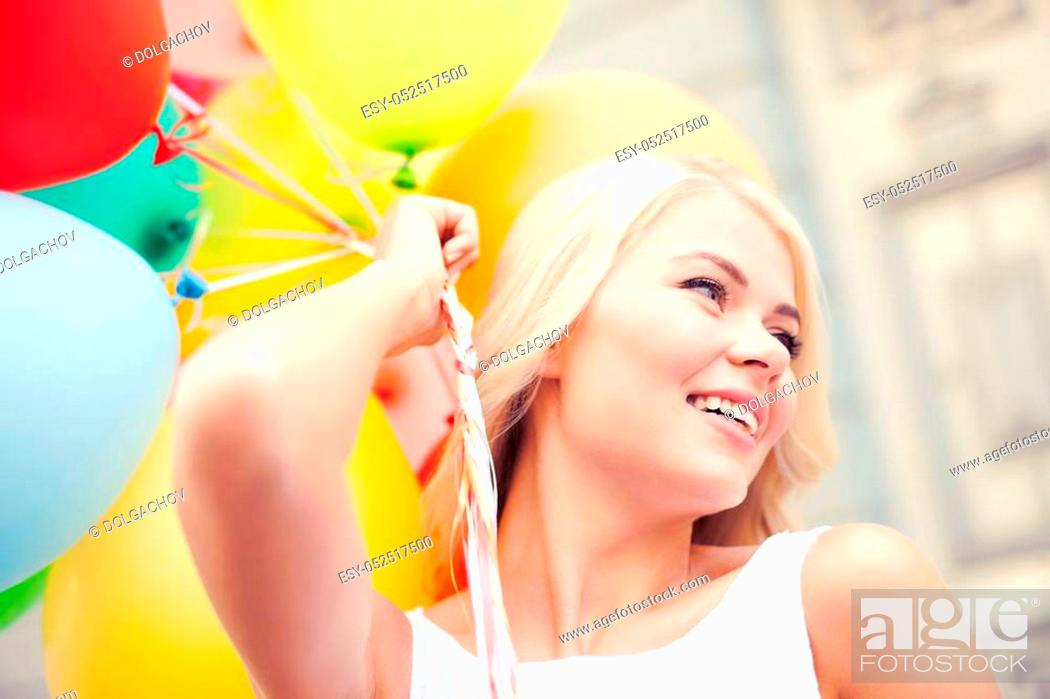 Stock Photo: summer holidays, celebration and lifestyle concept - beautiful woman with colorful balloons in the city.