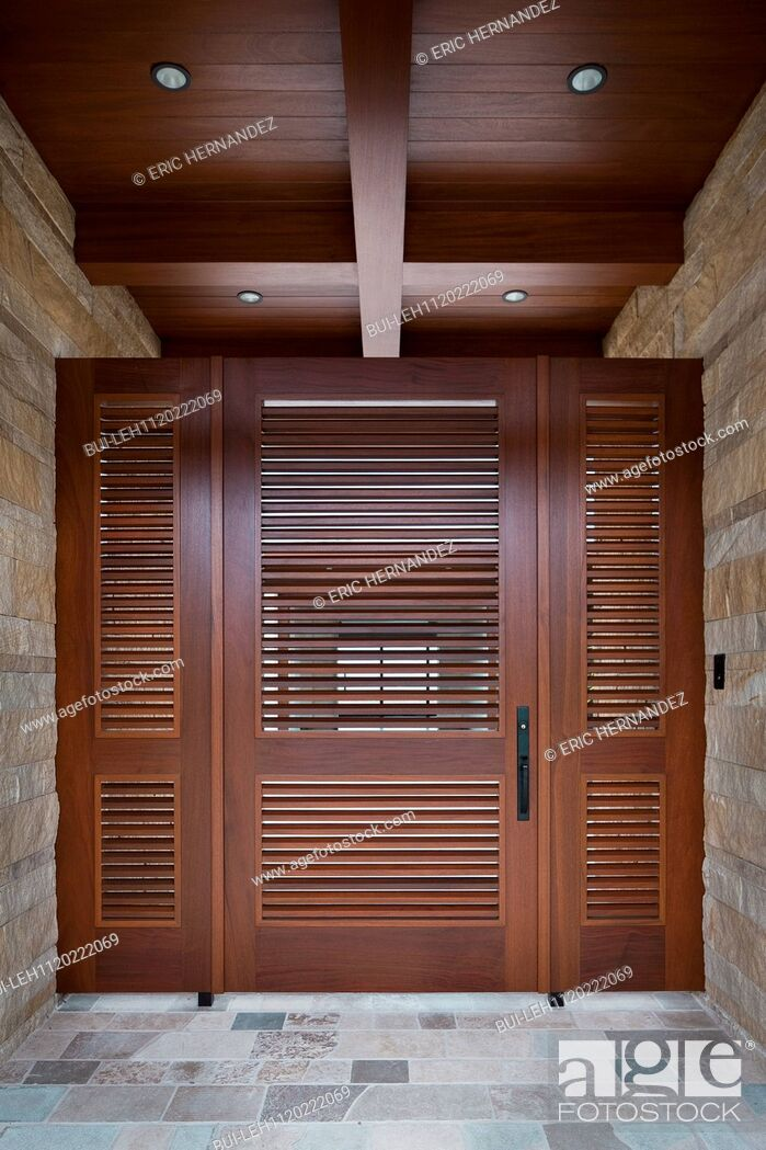 Stock Photo: Foyer with closed wooden door; Newport Beach; California; USA.