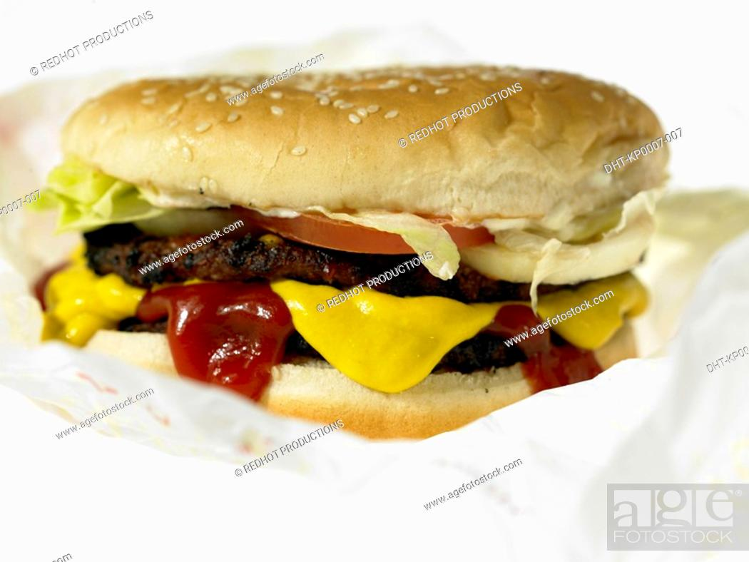 Stock Photo: One Beef burger with toppings in take out packaging.