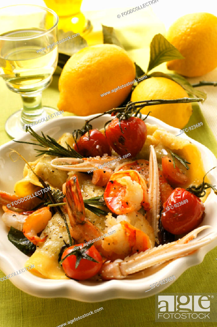 Stock Photo: Ravioli with scampi, tomatoes & rosemary, lemons, white wine.