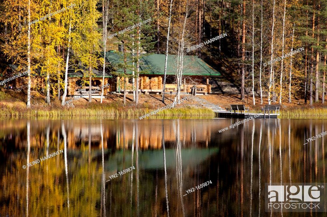 Stock Photo: Large sauna log cabin by a lake in the forest  Location Palolampi Lintharju Suonenjoki Finland Scandinavia Europe.