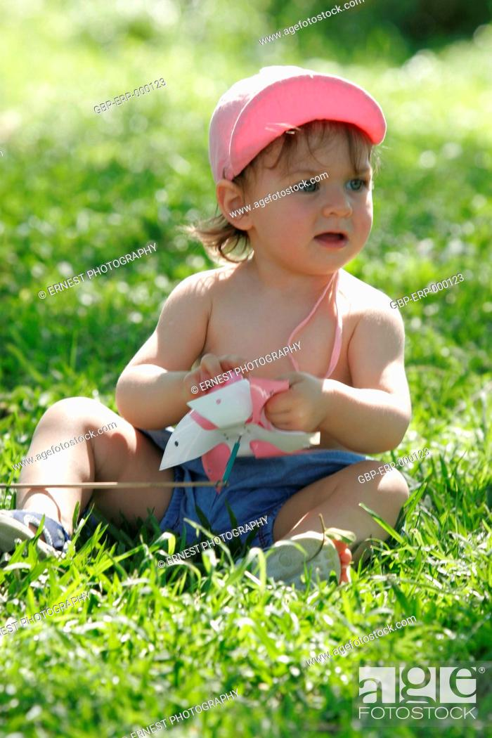 Stock Photo: Baby, 1 year; Sitting, grass, Isolated,.