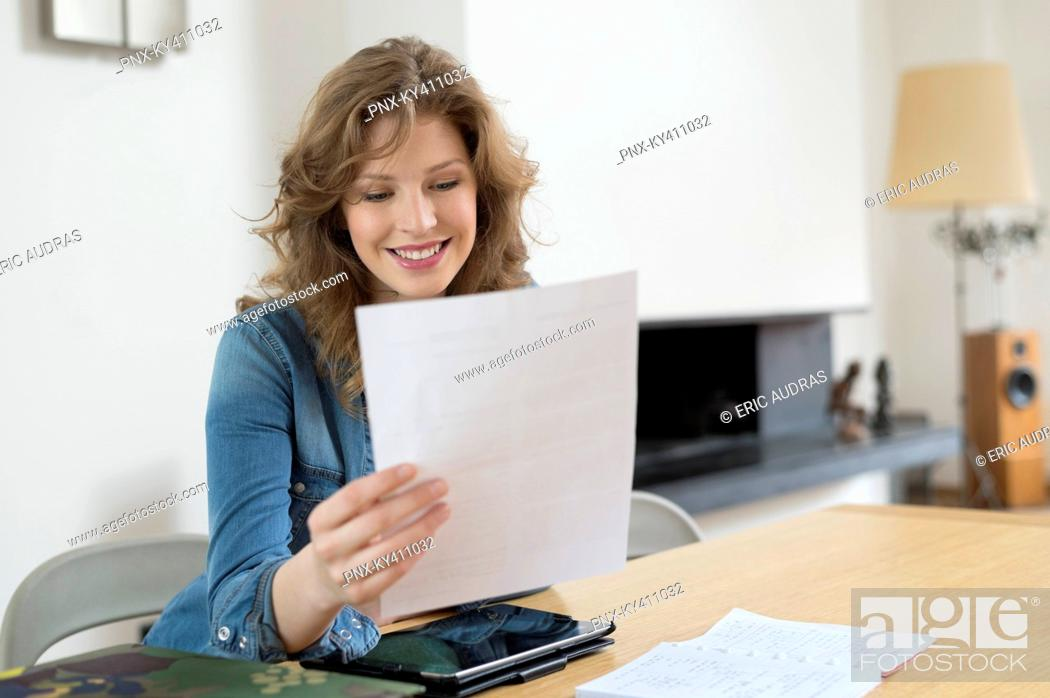 Stock Photo: Woman sorting out bills.