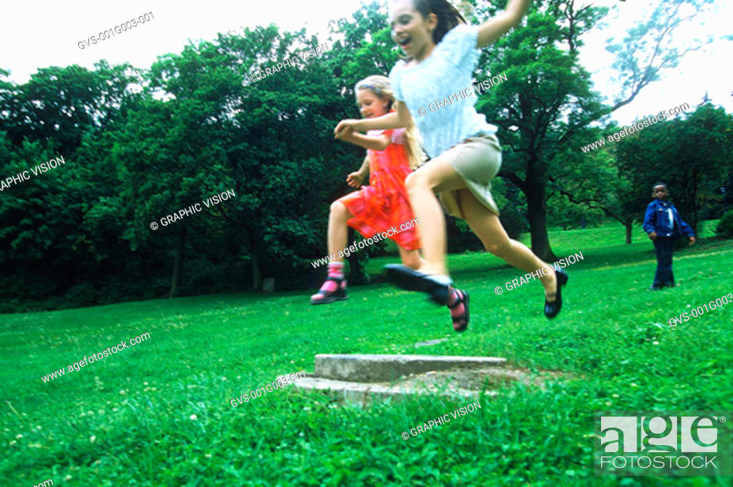Stock Photo: Young children jumping.