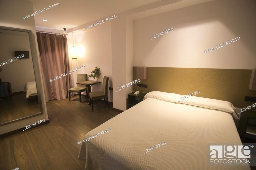 Stock Photo: Urban bedroom in hotel.