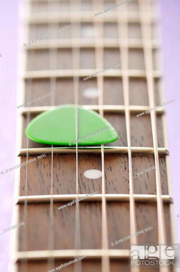 Stock Photo: guitar and pick.