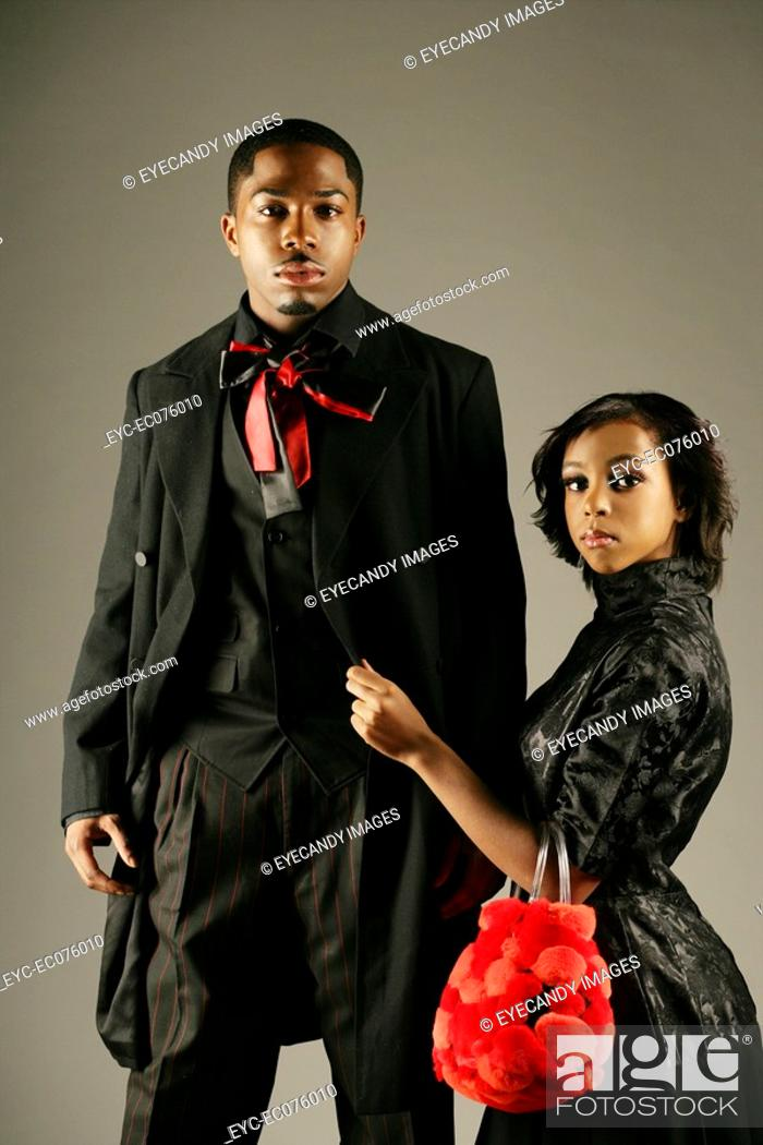 Stock Photo: Young stylish African American couple, studio shot.