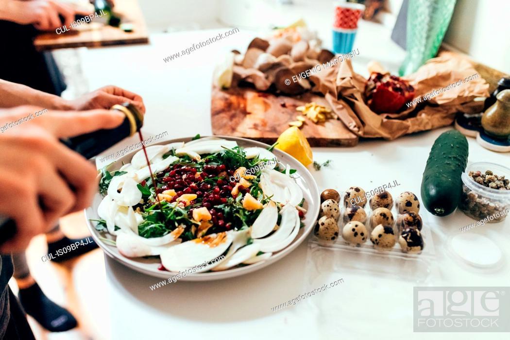 Stock Photo: Preparing food in kitchen.