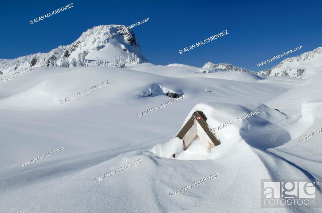 Stock Photo: Stone structure nearly buried by winter snows, North Cascades washington.