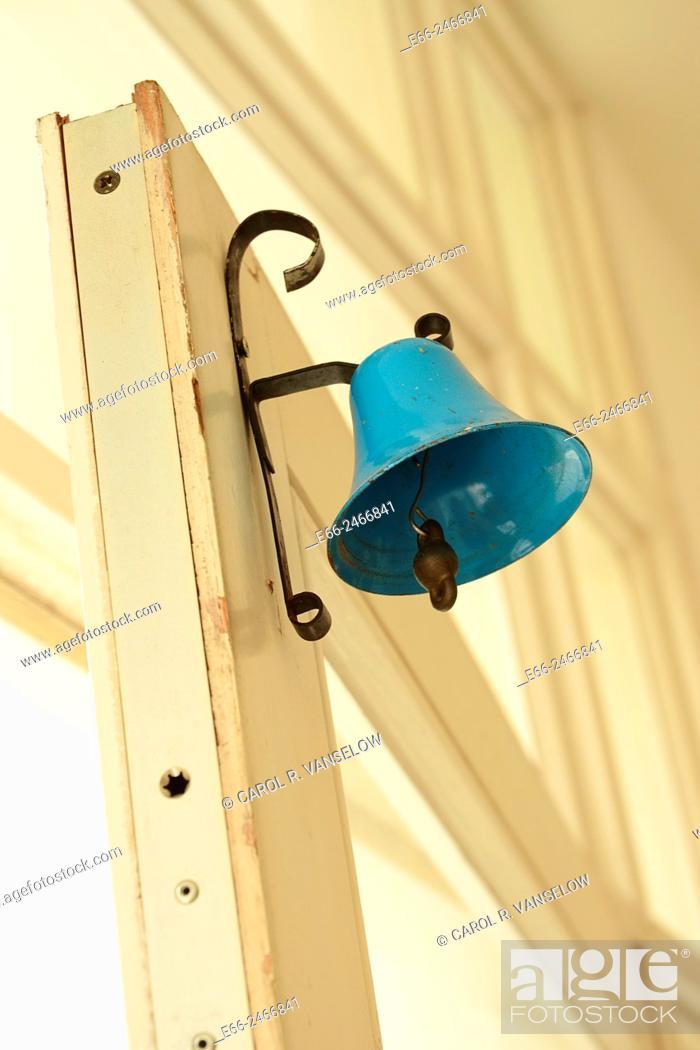 Stock Photo: Door of shop standing ajar. Bell on door to let shopkeeper know when someone is coming in.