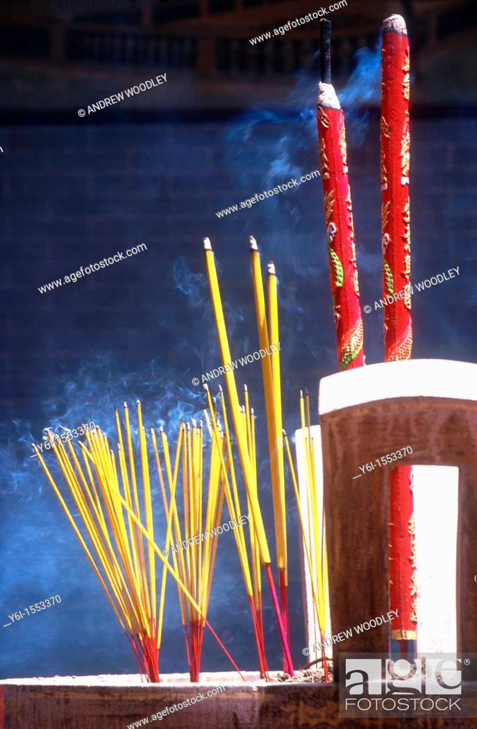 Stock Photo: Incense sticks burning at temple in Ho Chi Minh City Vietnam.