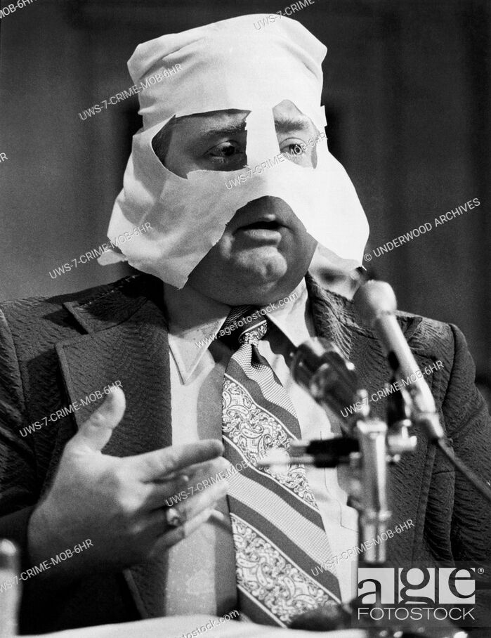 Stock Photo: United States: c. 1962.An unidentified man testifying at an unidentified hearing.