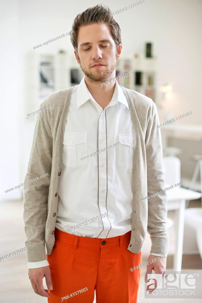 Stock Photo: Man standing with eyes closed.