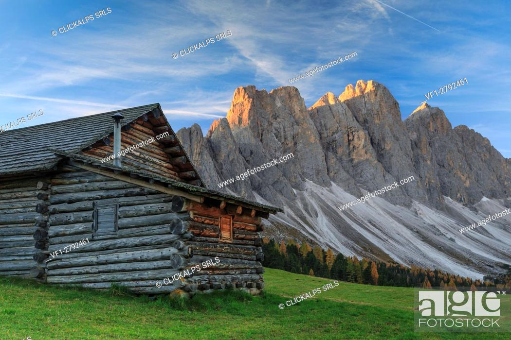 Stock Photo: The early morning light illuminates Malga Gampen and the Odle in background. Funes Valley South Tyrol Dolomites Italy Europe.