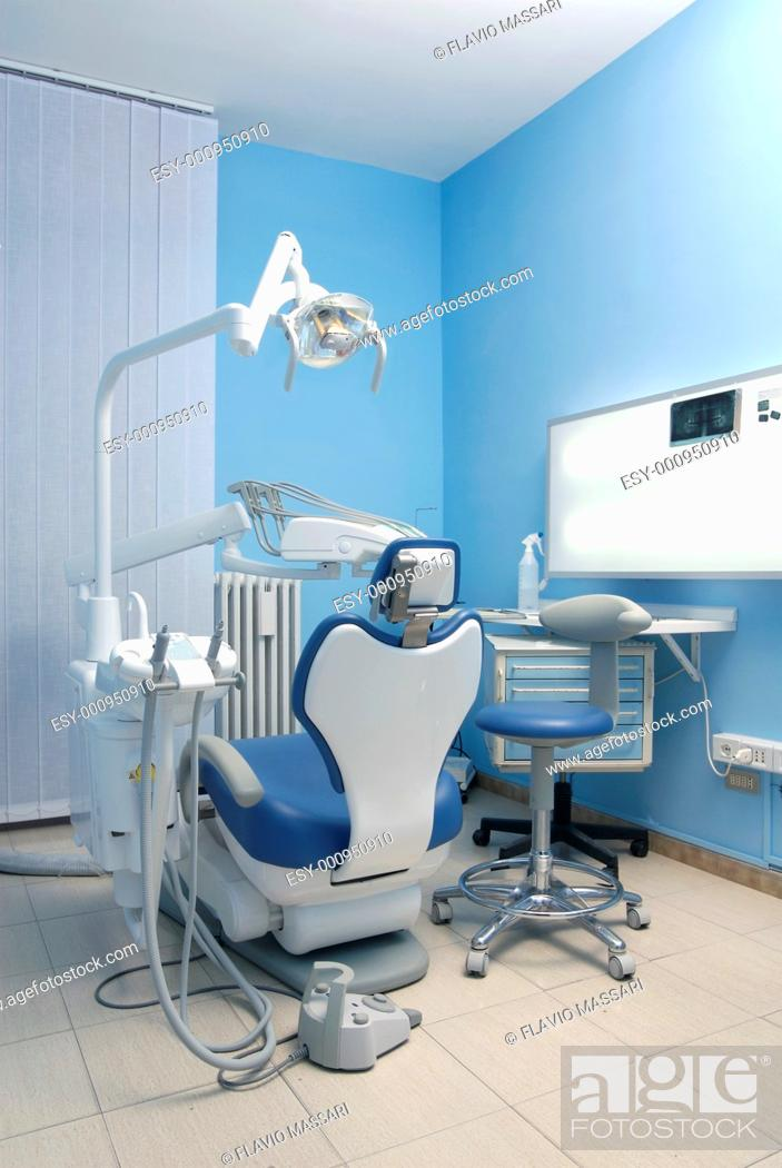 Stock Photo: modern Dentist's chair in a medical room.