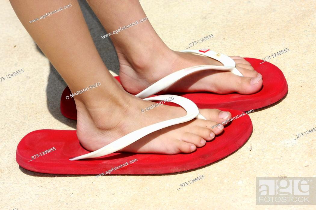 Stock Photo: Child's feet in a big sandal.