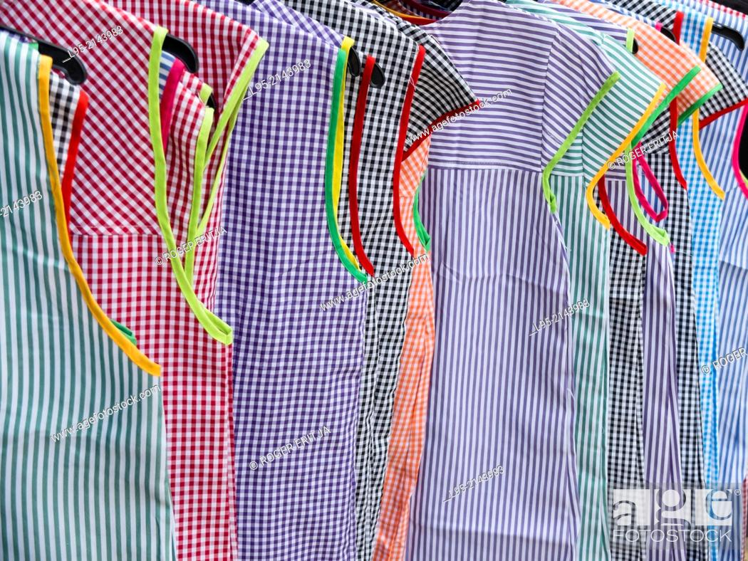 Stock Photo: Clothing and household apparel on sale at a street market, Miravet, Spain.