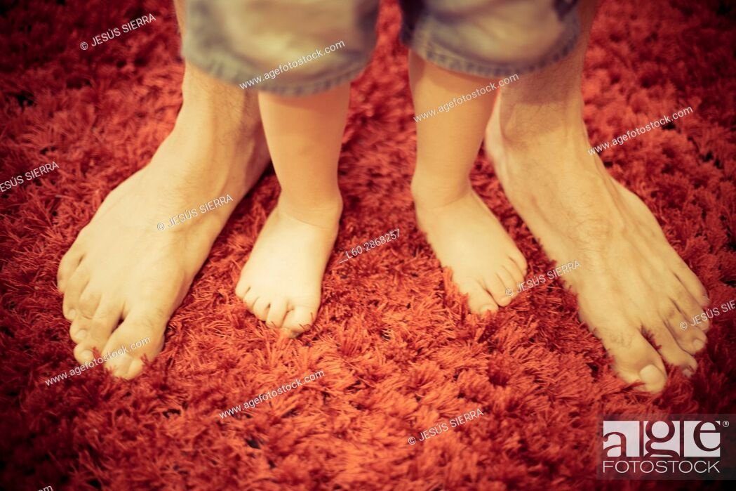 Stock Photo: Close-up, father and son feet.