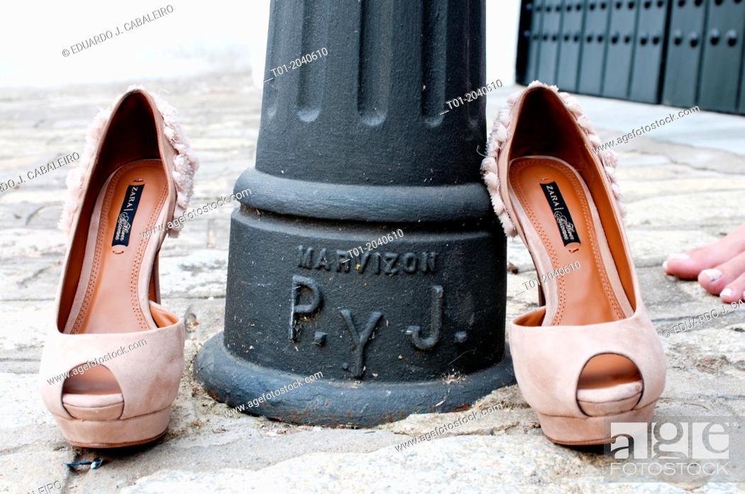 Stock Photo: female shoes with a lamppost.