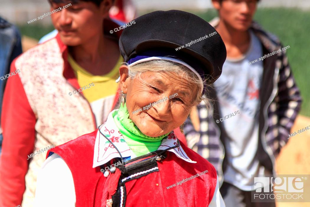 Stock Photo: Chinese woman dressed with traditional Bai clothing during the Heqing Qifeng Pear Flower festival, China.