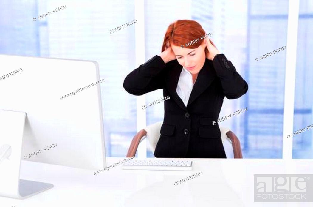 Stock Photo: Businesswoman Having Neck Pain At Computer Desk.