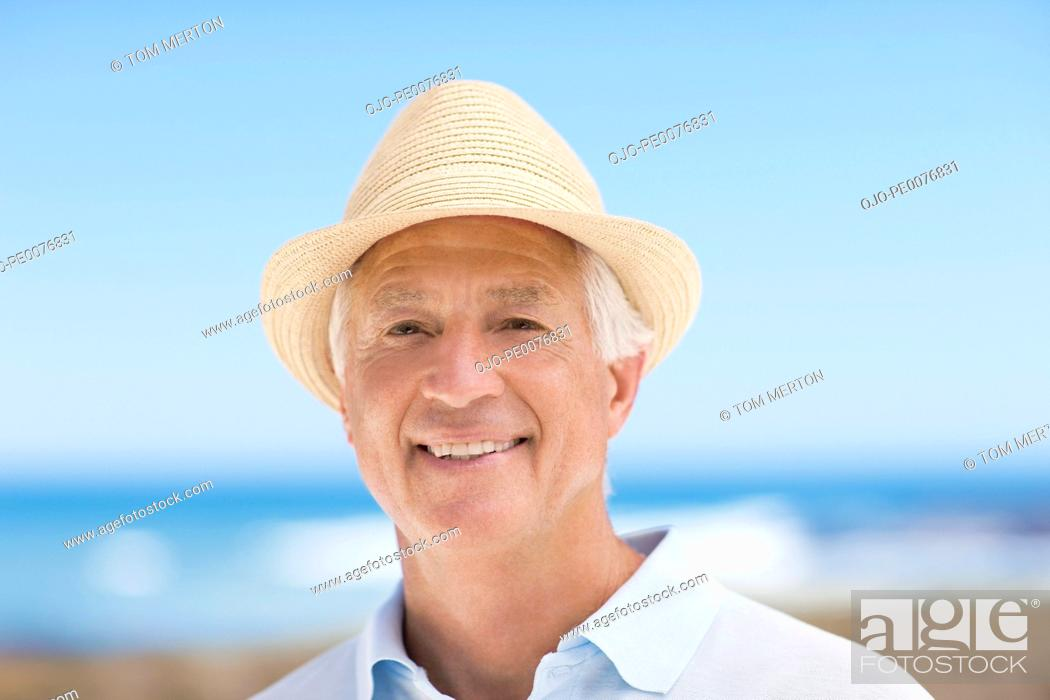 Stock Photo: Close up of smiling senior man in hat.