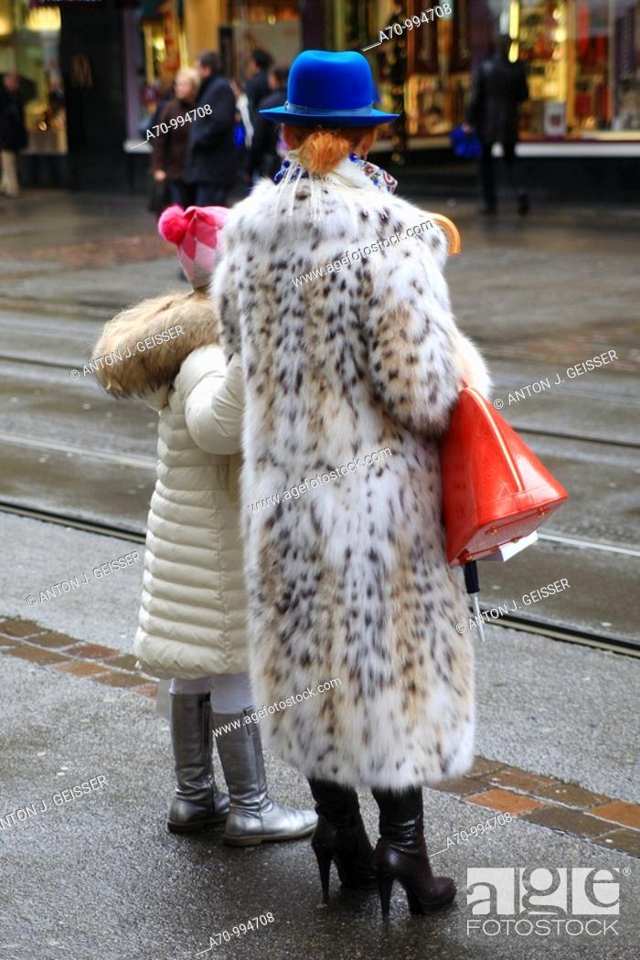 Stock Photo: Glamorous women with fur coat.