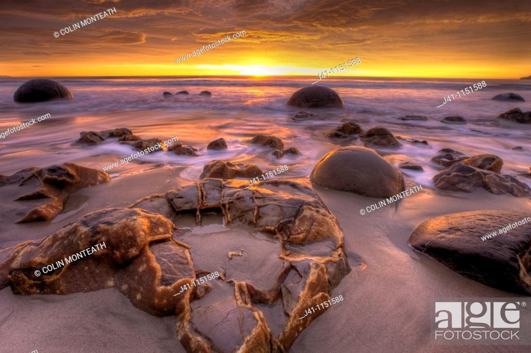 Stock Photo: Moeraki boulders at dawn as SW front passes overhead, near Oamaru, Otago,.