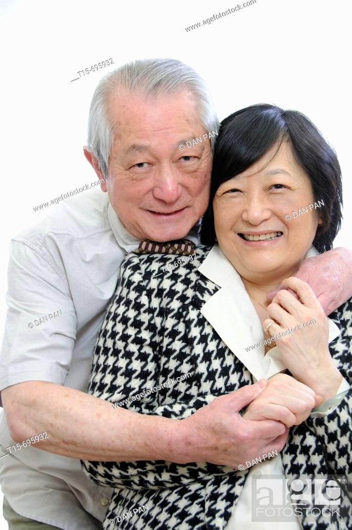 Stock Photo: Portrait of senior asian couple having fun together.
