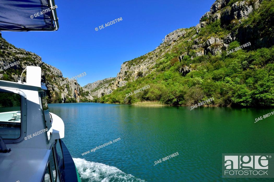 Stock Photo: Boat sailing on the Krka River from Roski Slap to the Monastery of Our Lady of Mercy (Gospa od Milosti), Krka National Park, Croatia.