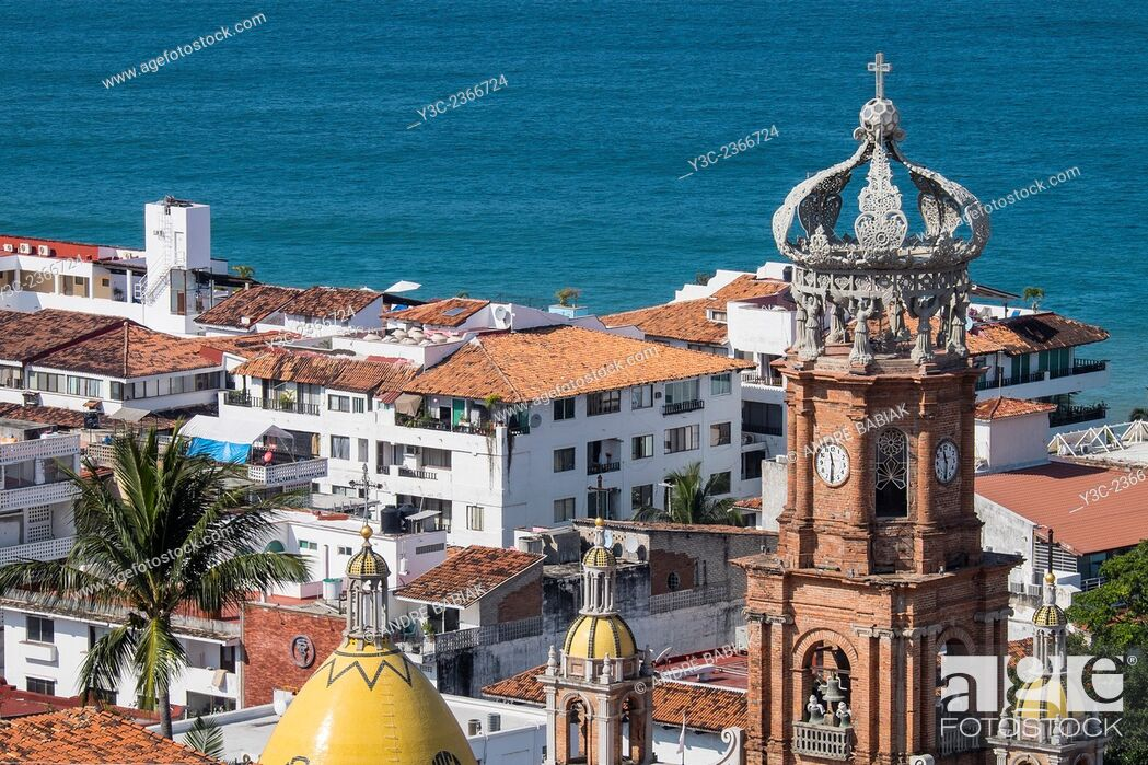 Stock Photo: Close up of El Centro Puerto Vallarta with Tower of Church of Our Lady of Guadalupe.