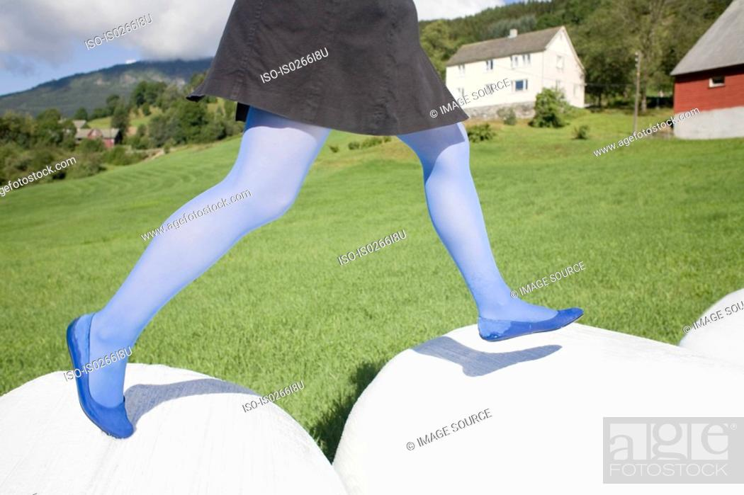 Stock Photo: Woman running in a field.