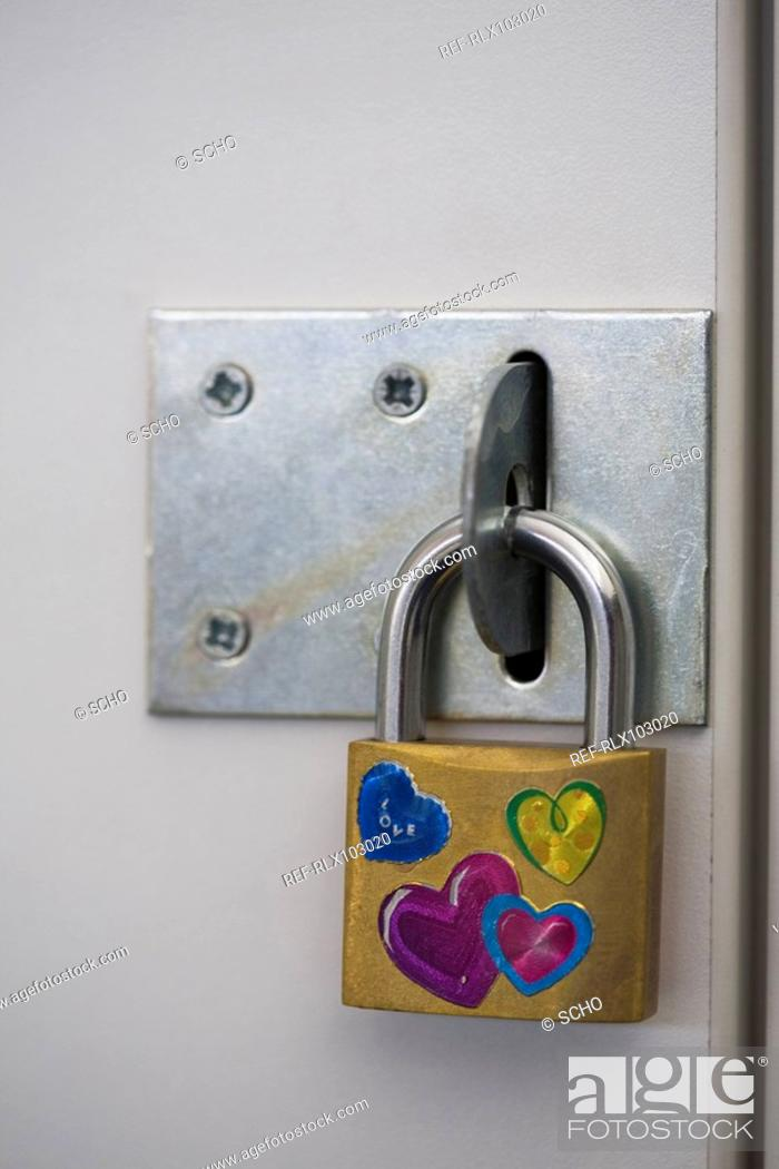Stock Photo: Padlock on school locker with heart stickers.